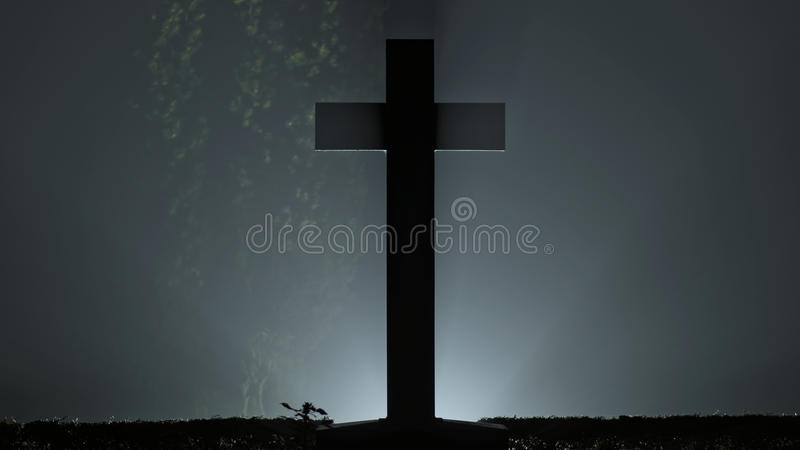 Cross with back light in fog. Christian cemetery Cross with back light in fog royalty free stock images