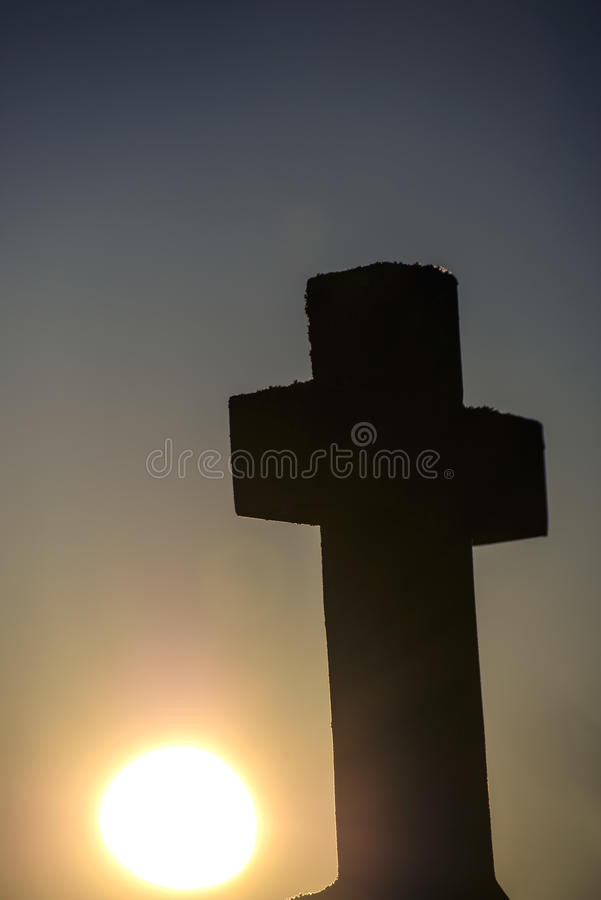Cross in back light. With sunset stock photos