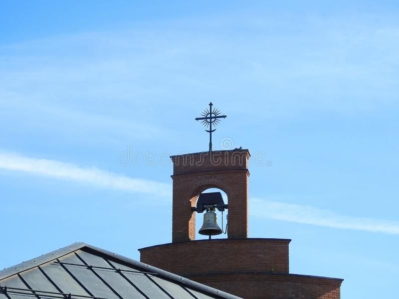 Cross and bell on church top, Lithuania royalty free stock photography