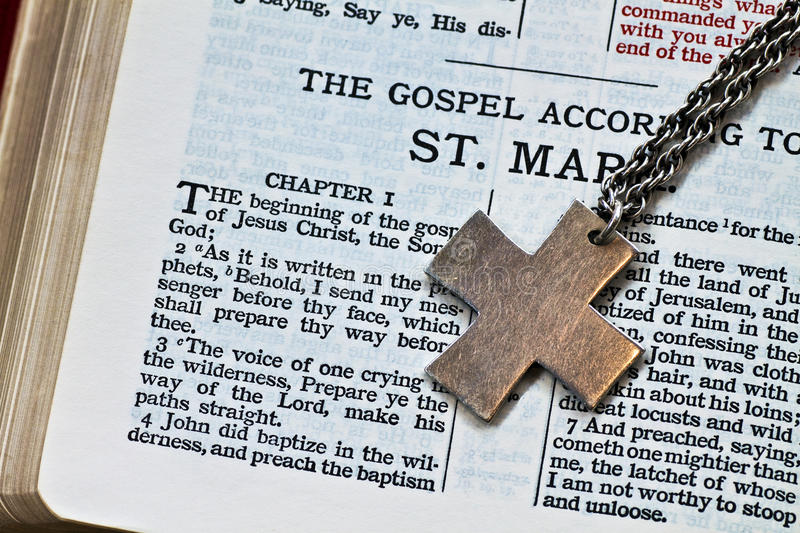 Cross and Bible. Bible with a cross as a bookmark royalty free stock images