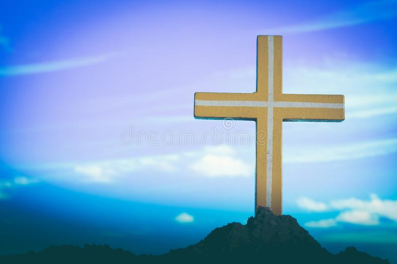 Cross on blurry sunset background. Yellow cross on blurry sunset background. Christian, Christianity royalty free stock photography