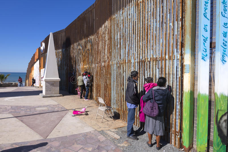 Cross border family meetings. PLAYAS DE TIJUANA, MEXICO - JANUARY 28, 2017: Mexican families living in Tijuana visit with family members living in the United royalty free stock photos