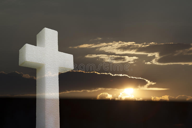 Cross into Bright sunlight shining through clouds stock photography