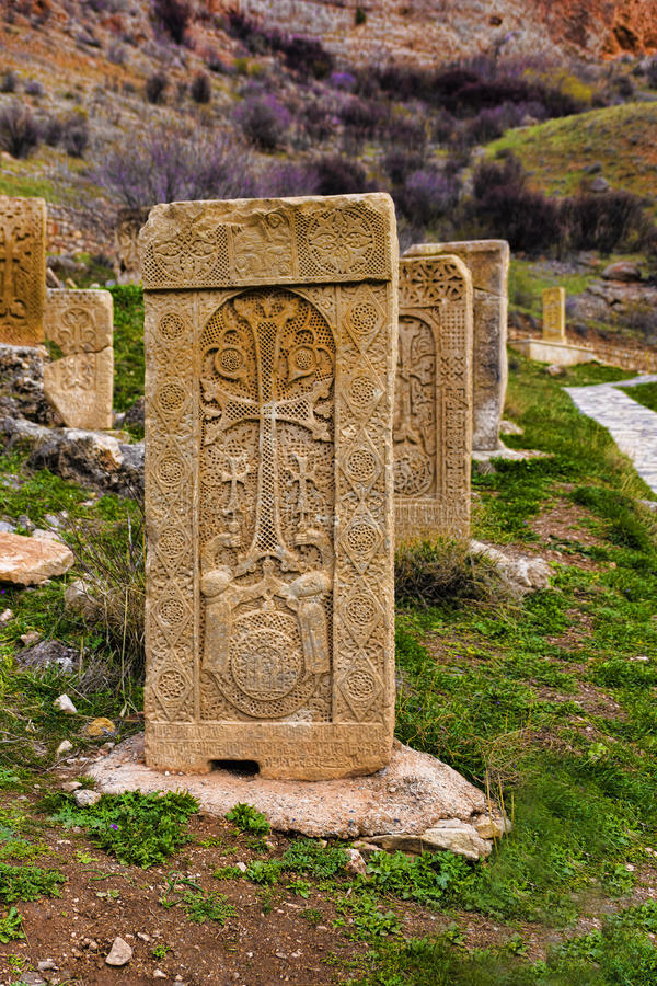 Cross carved on orange stone stock photos