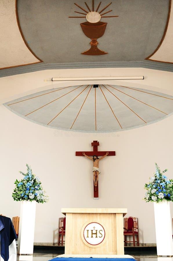 Cross at the catholic church altar stock photography
