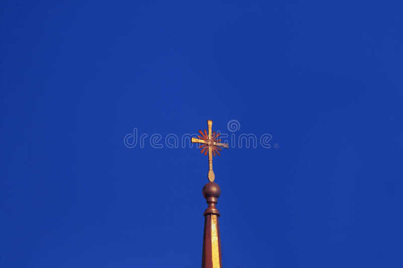 Cross on a church. Christian golden cross on a church against the sky royalty free stock images