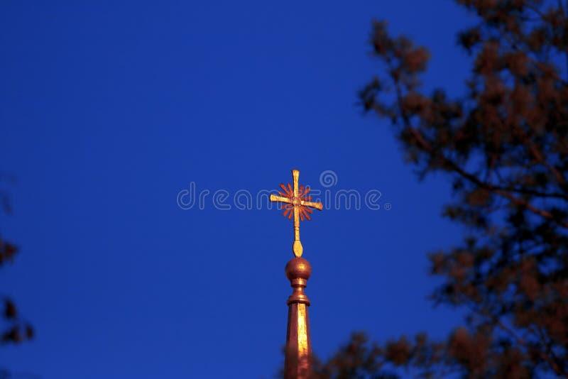 Cross on a church. Christian golden cross on a church against the sky royalty free stock photo