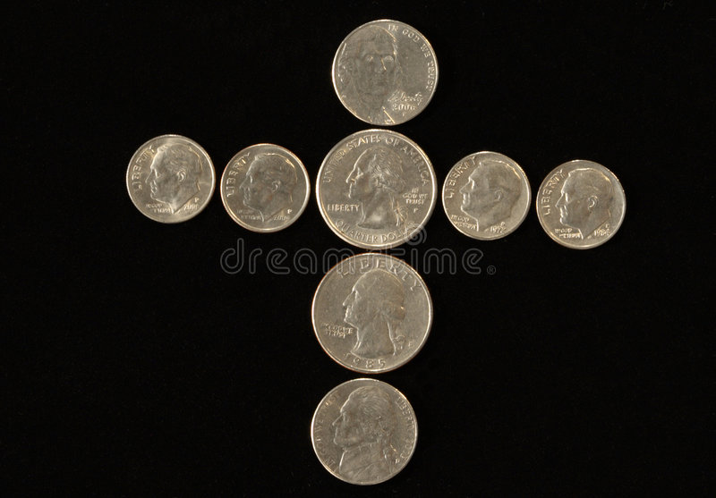 Cross of coins stock photo