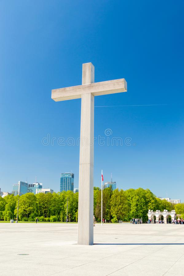 The cross commemorates Pope John Paul II`s celebration of Holy Mass in the Pilsudski square in 1979. Warsaw, Poland - April 20, 2018: The cross commemorates stock photography
