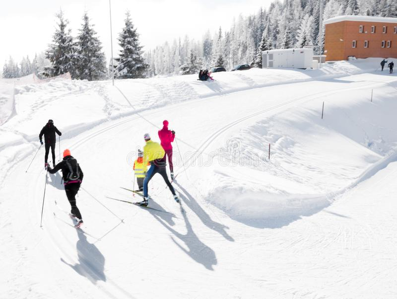 Cross country skiers moving up the hill stock photography