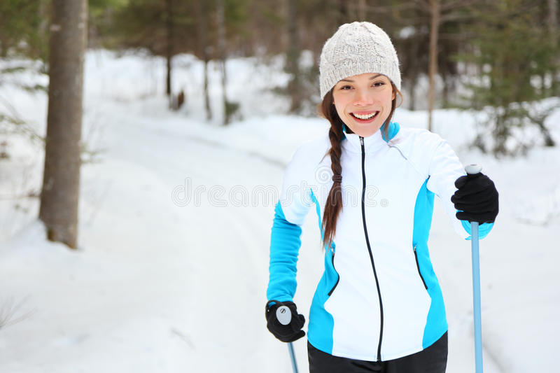 Cross-country skiing. Woman doing classic nordic cross country skiing in trail tracks in snow covered forest in Quebec, Canada stock images