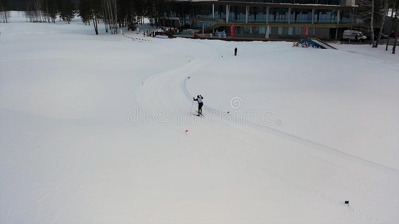 Cross country skiing skating technique practiced by man dressed in special uniform, winter sports games concept. Footage royalty free stock photography
