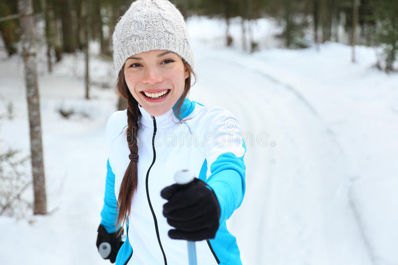 Cross-country skiing woman on ski. Cross-country skiing woman doing classic nordic cross country skiing in trail tracks in snow covered forest in Quebec, Canada royalty free stock images
