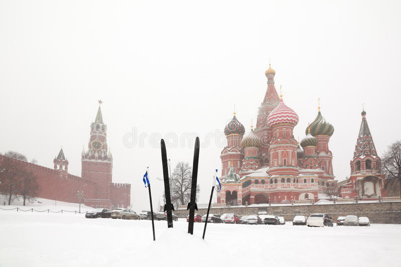 Cross-country skis and poles stuck in snow stock image