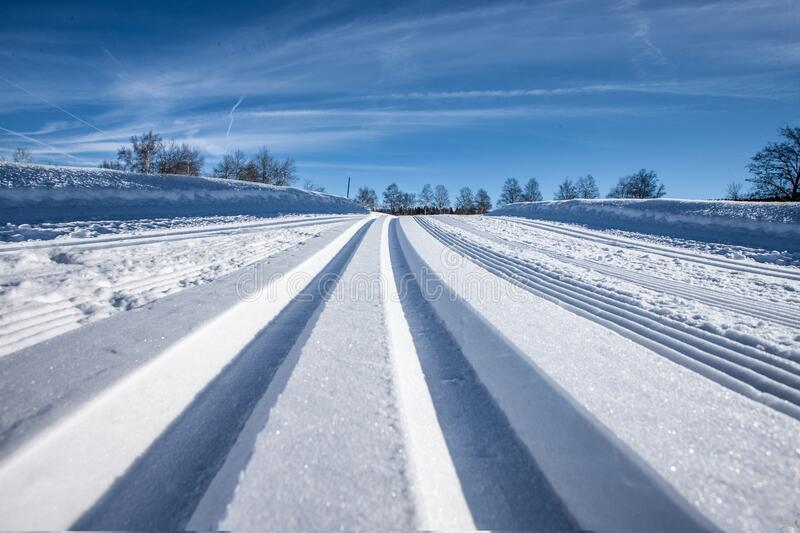 Cross country tracks in snow on Zugerbeg switzerland. Clean tracks in Snow stock photography