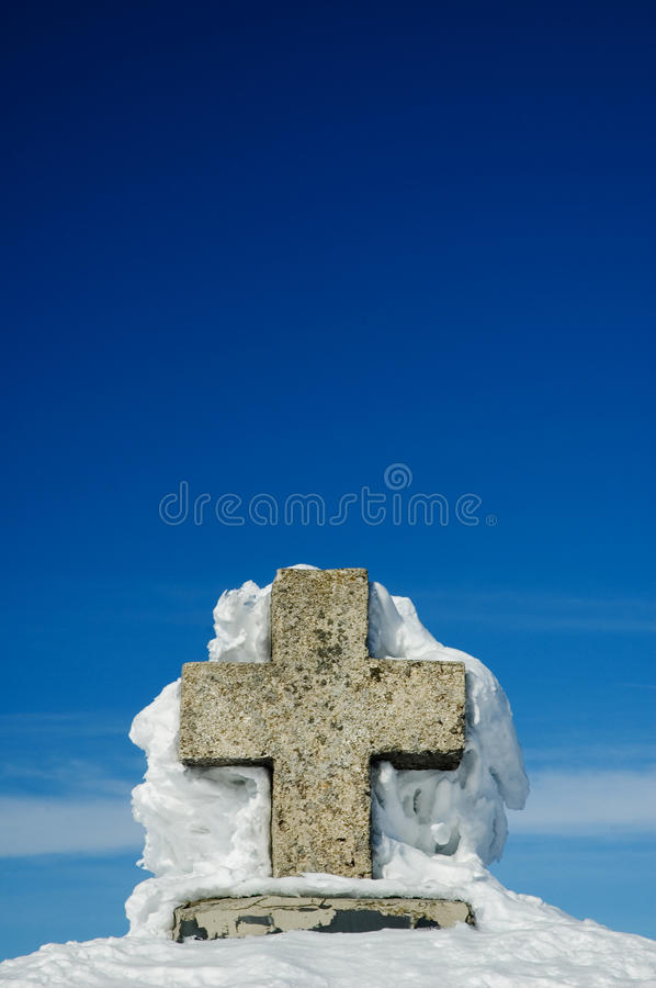 Cross covered by snow royalty free stock photography