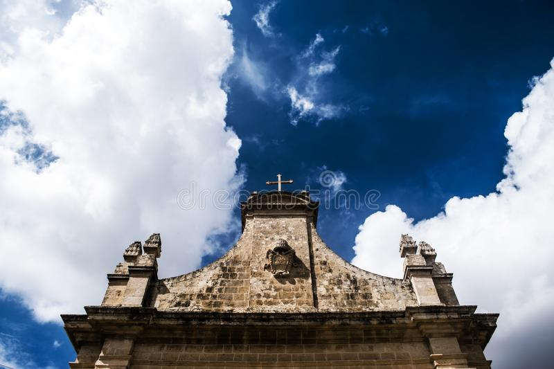 The Cross. At the top of a small chapel known as Tal-Hlas in Zebbug and Qormi in Malta royalty free stock image