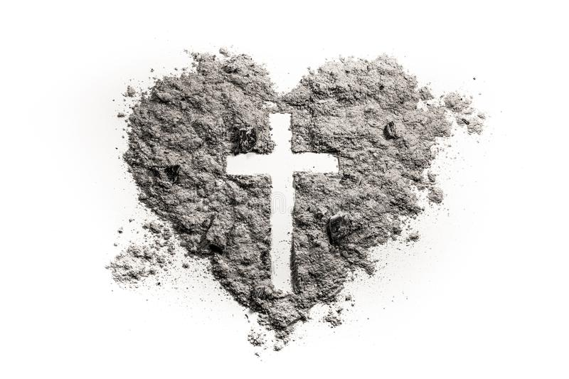 Cross or crucifix in heart symbol made of ash royalty free stock images