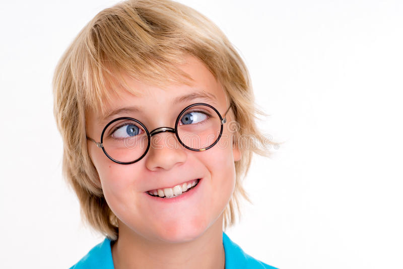 Cross-eyed blond boy. Portrait of a cross-eyed blond boy royalty free stock photography