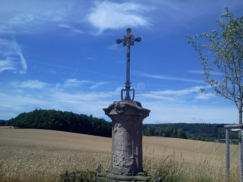 Cross in the field royalty free stock photos
