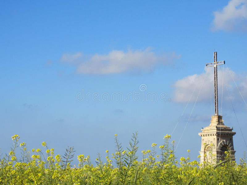 Cross in a flower field royalty free stock images