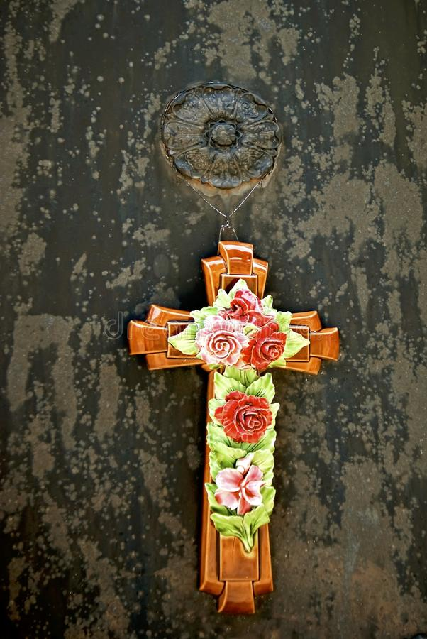Cross with flowers stock photography