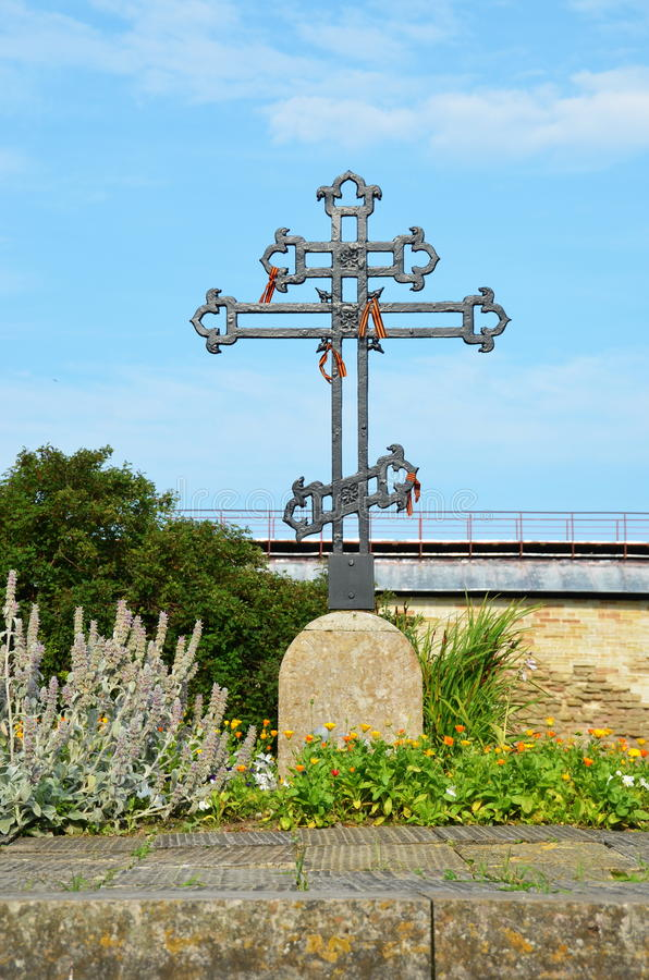 Cross in Fortress Oreshek. The cross on the common grave of Russian soldiers of 1702. Fortress Oreshek in Shlisselburg stock photography