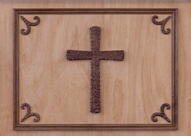 Cross framed on wooden wall stock images