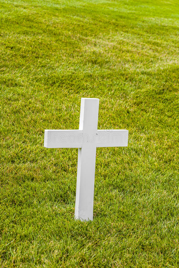 Cross on a grave at Arlington National Cemeterey. White cross on a grave at Arlington National Cemetery, a United States military cemetery in Arlington County royalty free stock images