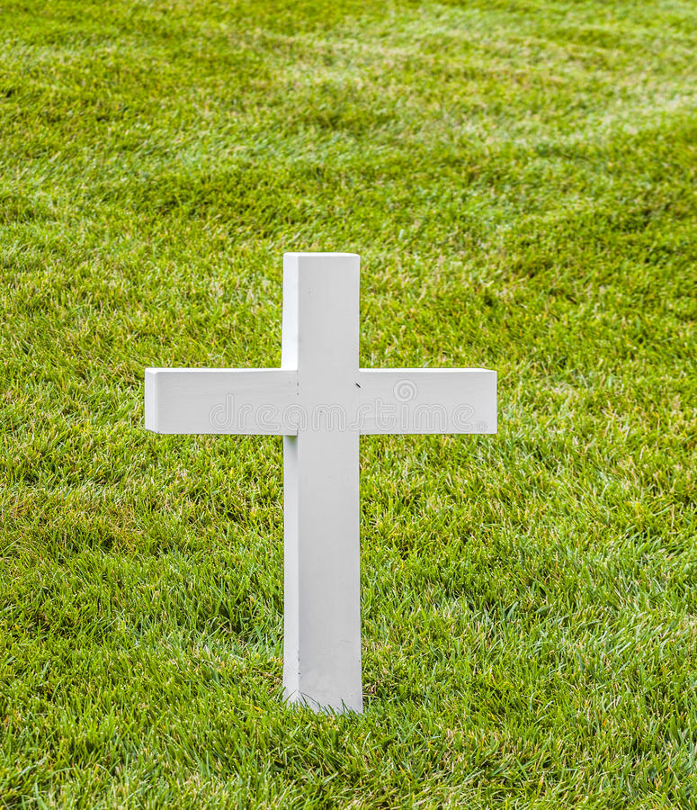 Cross on a grave at Arlington National Cemeterey. White cross on a grave at Arlington National Cemetery, a United States military cemetery in Arlington County royalty free stock photos