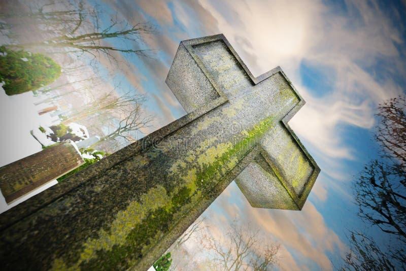 Cross on graveyard stock photo