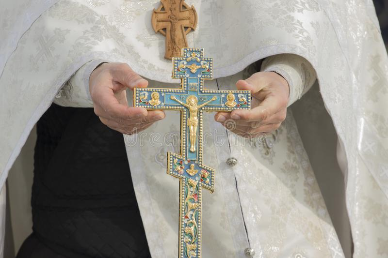 The cross in hand stock photo