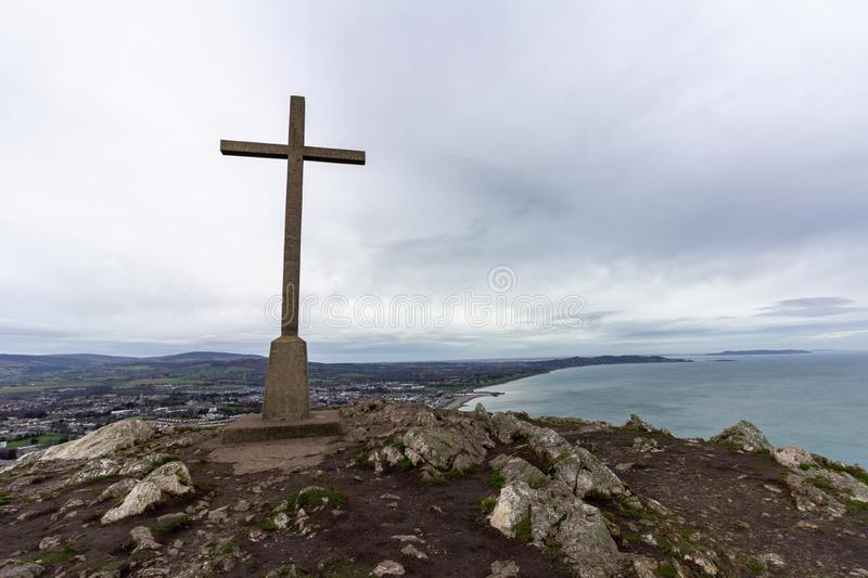 Cross at the highest point in Bray Head overlooking the Irish coastline. At the highest point on Bray Head is a cross overlooking the Irish coastline toward stock image