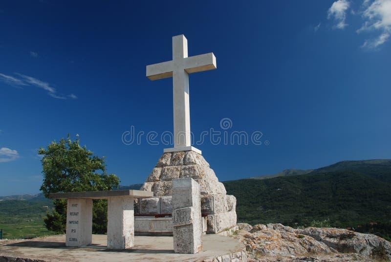 Cross on the hill above Stari Grad. Big cross on the mountain Glavica, Stari Grad, Island Hvar, Dalmatia, Croatia stock photos