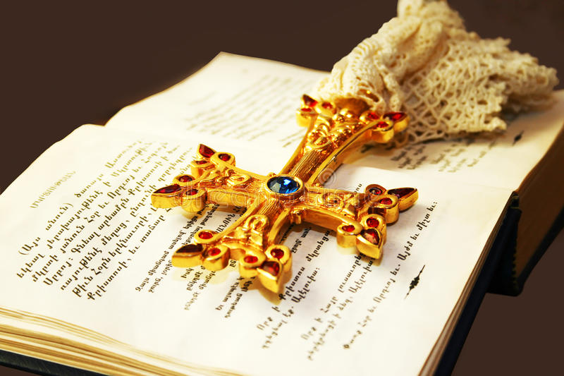 Cross on Holy Bible. Golden cross with gemstones on Holy Bible royalty free stock photography