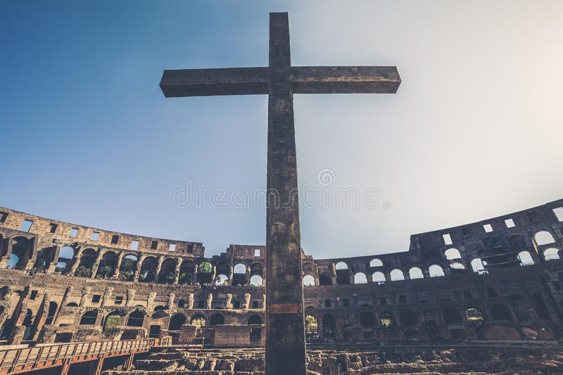 Cross inside the Colosseum of Rome in Italy. Flavian Amphitheater, antiquity of the Roman Empire. stock photos