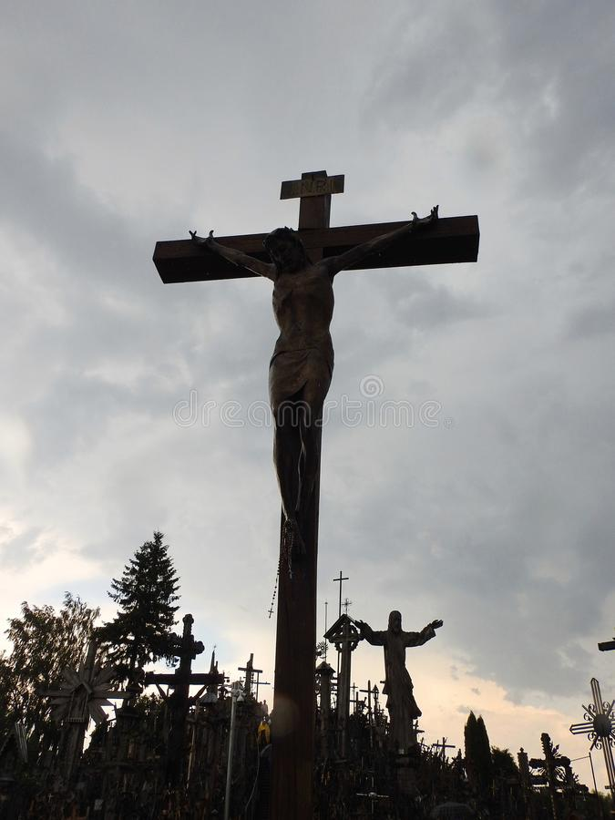 Cross and Jesus Christ statue in Cross hill, Lithuania stock photo