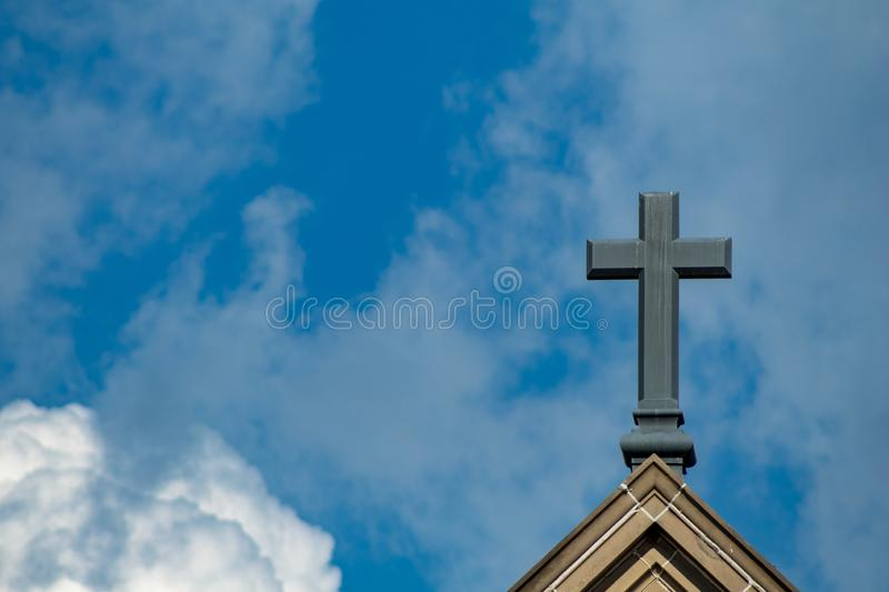 Cross of Jesus. Christian cross amid the clouds stock image