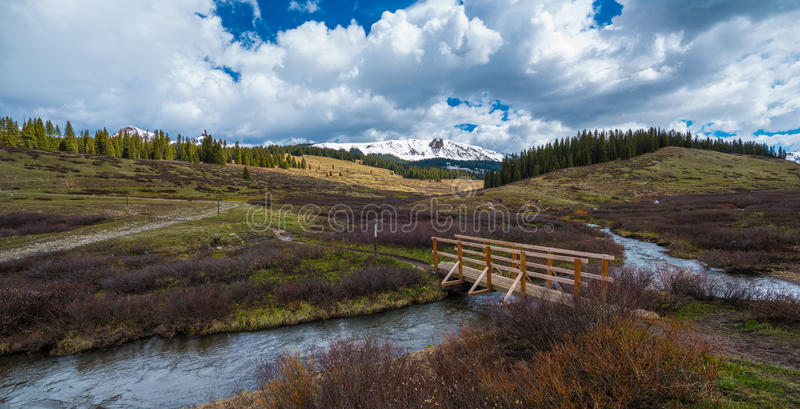 Cross Mountain Lizard Head Peak Colorado Rocky Mountains Landsca. Creek and a foot bridge, Colorado Rocky Mountains Landscape stock image