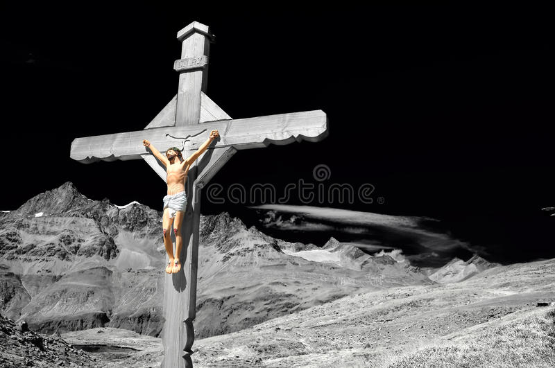 Cross in the mountains royalty free stock image