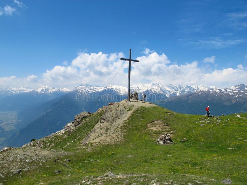 Cross on mountaintop Italy South Tyrol Spitzige Lun. South Tyrol, Italy - June 17, 2013: A cross marks the summit of the Spitzige Lun, a 2324 meter high Alpine stock photo
