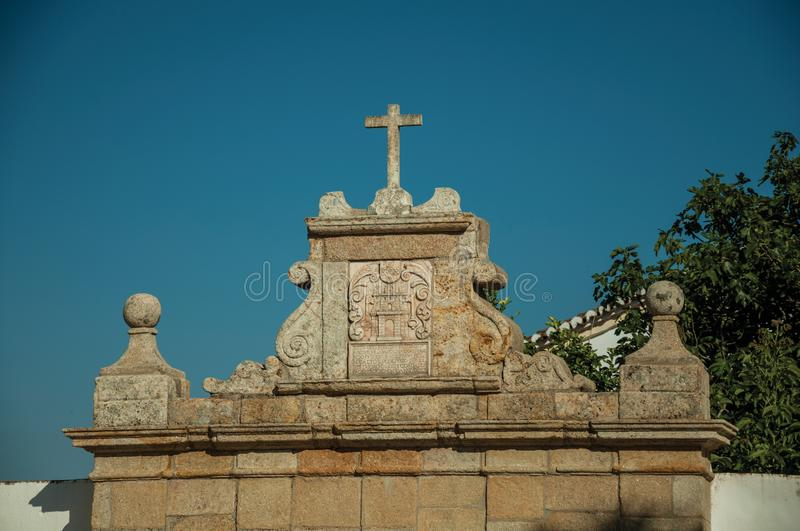 Cross over wall decorated in baroque style at Marvao stock photography