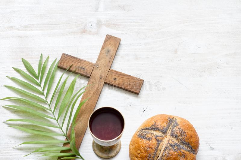 Cross and palm on wooden white background easter sign symbol concept. Closeup stock photos