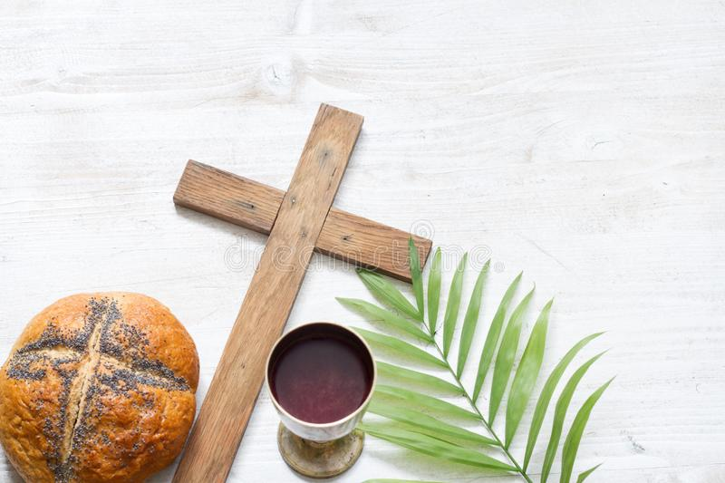 Cross and palm on wooden white background easter sign symbol concept royalty free stock photos