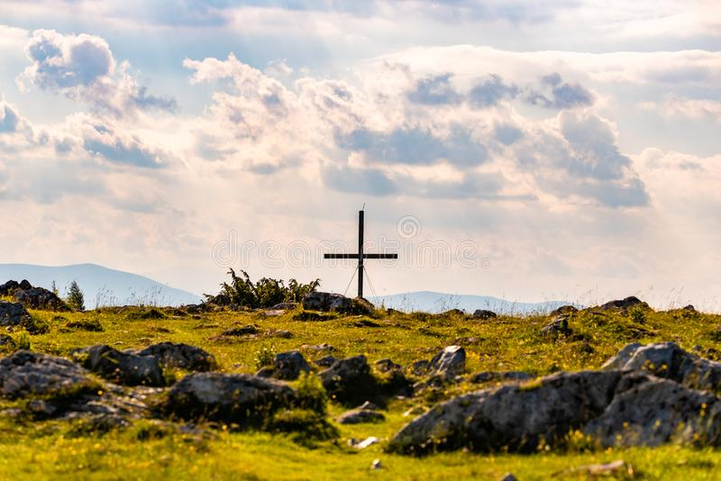 Cross on a peak of Austrian mountain Schockl in Styria Graz. Cross on a peak of rocky Austrian mountain Schockl in Styria Graz. Place for tourism and hiking stock image