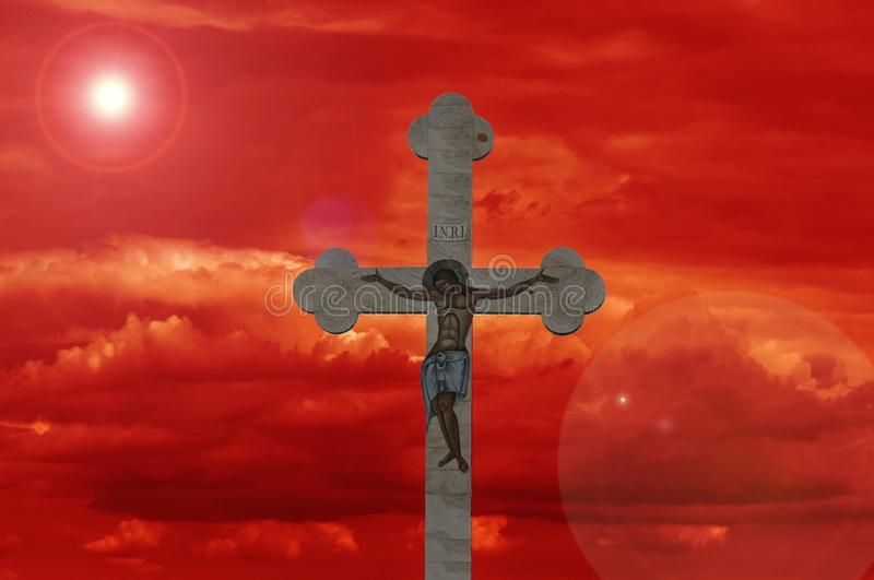 Cross with red sky stock images