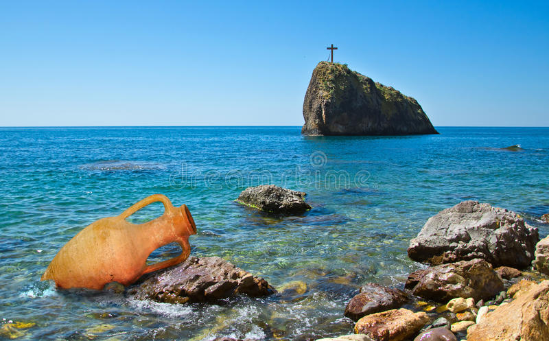 Cross on rock royalty free stock photo