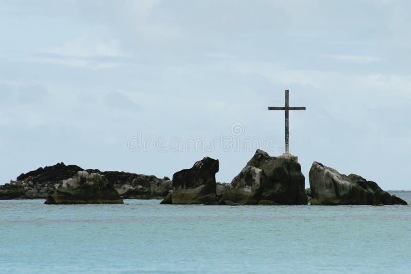 Cross on the rocks stock photo