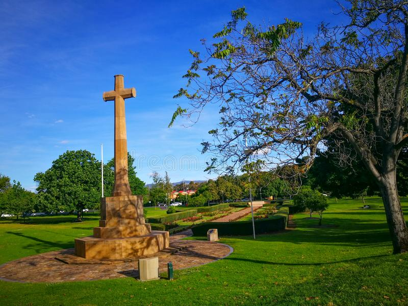 The Cross of Sacrifice Memorial Women`s War Memorial is dedicated to the memory of all who paid the supreme sacrifice in war. stock photos