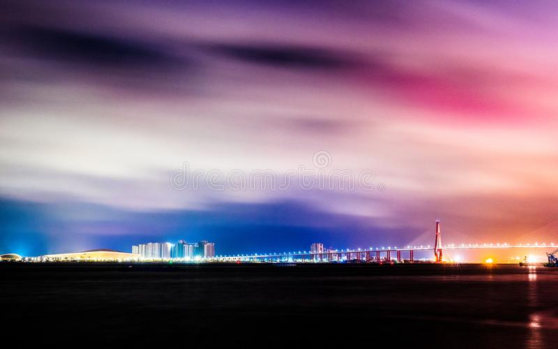 Cross-sea bridge with lights and colorful sky in Zhanjiang royalty free stock photography